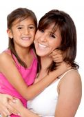 image of mother daughter  - Mother and daughter smiling isolated over a white background - JPG