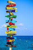 pic of mexican  - Funny direction signpost with distance to many different countries on Mexican coastline - JPG