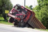 stock photo of mutilated  - The truck lies in a ditch after the road accident - JPG