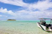pic of breathtaking  - picture perfect view at the island breathtaking lagoon and anchored boat at cook islands aitutaki - JPG
