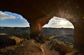 stock photo of volcanic  - Volcanic Formation Natural Arch in the Desert Tenerife Canary Islands Spain - JPG