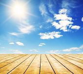 pic of puffy  - Wooden boards over a blue sky - JPG