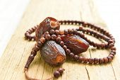 stock photo of beads  - Saudi dates with islamic prayer beads - JPG