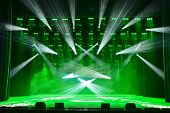 picture of soffit  - Illuminated empty concert stage with smoke and rays of light - JPG