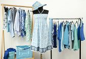 foto of dress mannequin  - Dressing closet with blue clothes arranged on hangers - JPG