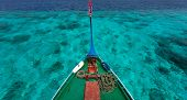 picture of dhoni  - Close up of a traditional maldivian boat dhoni in a tropical ocean - JPG