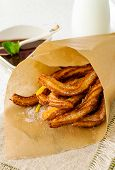 foto of churros  - Typical Spanish fried pastry for dessert  - JPG