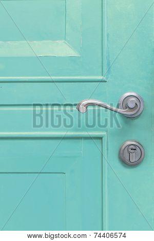 Classic Door Handle On Blue Door