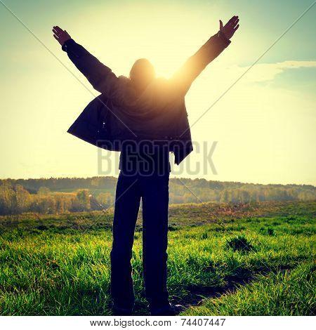 Praying Man At Sunset