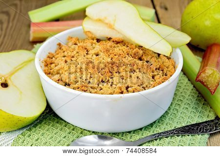 Crumble with pears and rhubarb on board