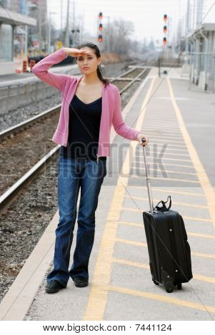 woman looking for the train