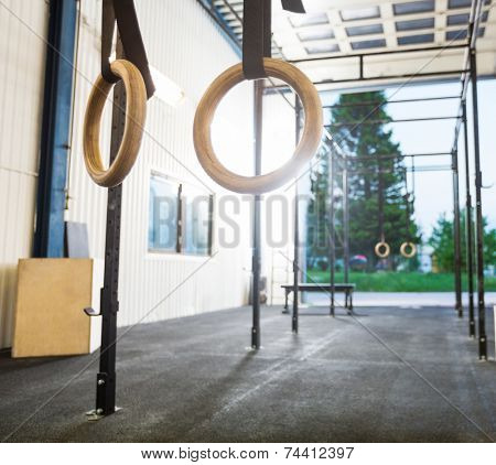 Gymnastic rings hanging in gym