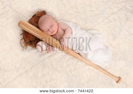Swaddled Sleeping Baby Boy With A Baseball Bat