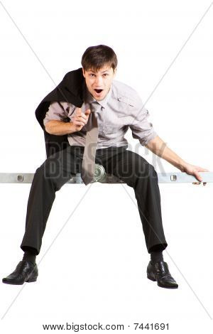 Young Businessman Sitting On Ladder, Screaming. Isolated