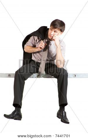 Young Businessman Sitting On Ladder, Thinking.isolated
