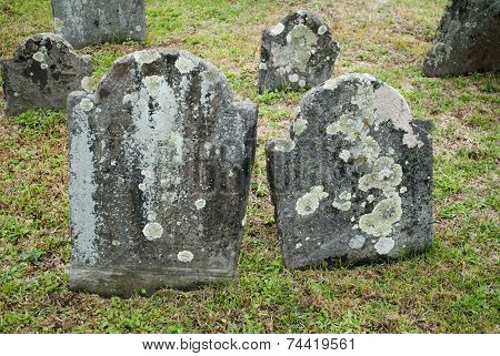 Old And Spooky Grave Stones In A Cemetery