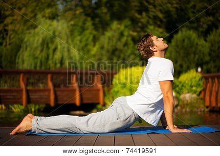 Yoga man in cobra pose
