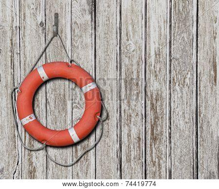 Lifebuoy on wood white background