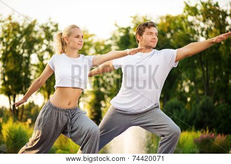 Young couple practising yoga