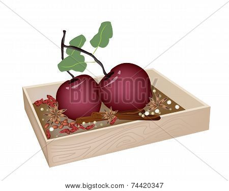 Christmas Apples and Spices in Wooden Container