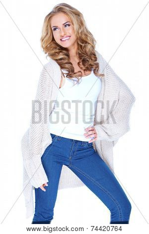 Smiling Attractive Blond Female in Knit Cardigan Fashion Outfit. Posing on White Background.
