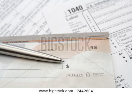 Check And Silver Pen With Tax Form