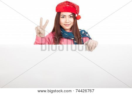 Asian Girl With Red Christmas Hat Show V Sign  Behind Blank Sign