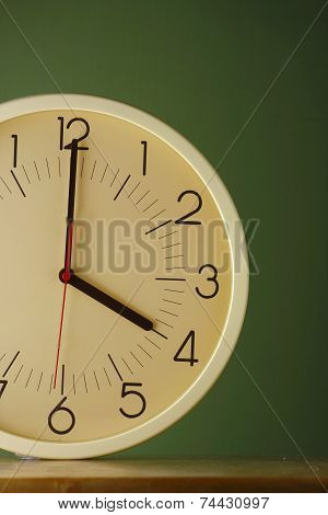 An analog clock at four o'clock position