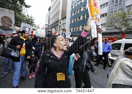 Female marcher with sign