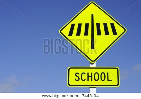 Zebra Crossing Road Sign With School