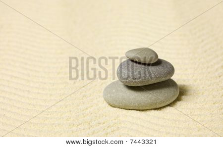 Pyramid Of Three Stones On Sand