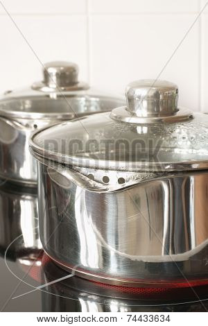 Saucepans On A Halogen Hob