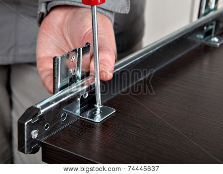Assembling Of Furniture, Install  Drawer Slides, Screwing Screw Manual Screwdriver.