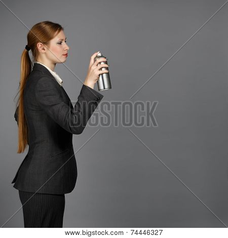 Business Woman With Spray Can