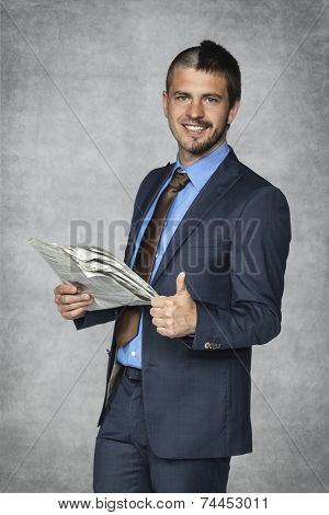 Happy Businessman Reading A Daily Newspaper