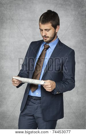 Serious Businessman Reading Morning Newspapers