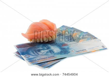 dentition and swiss franc symbol photo for dentures, treatment costs and payment