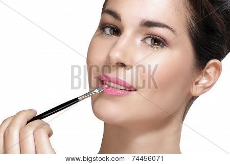 Beautiful Young Woman Applying Lipstick With Brush