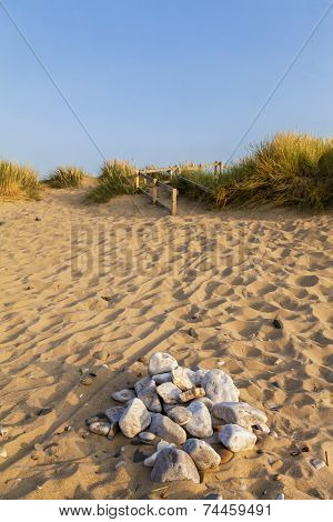 Scenic View Of A Golden Sandy Beach In The Summer Evening Light .