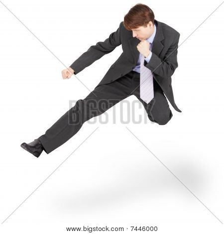 Fighting Businessman Kicked In Jump, Isolated On White Background
