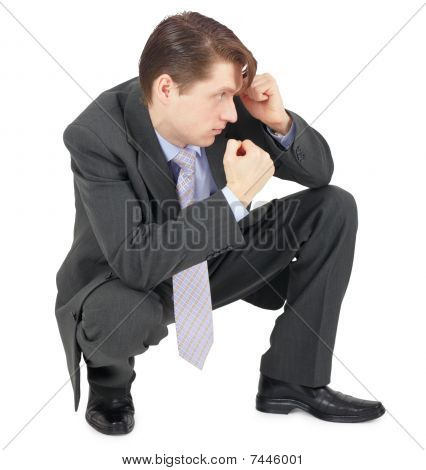 Businessman Sitting In Defensive Pose
