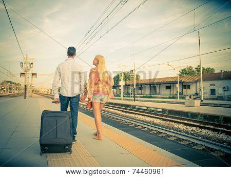Couple Walking At Train Station