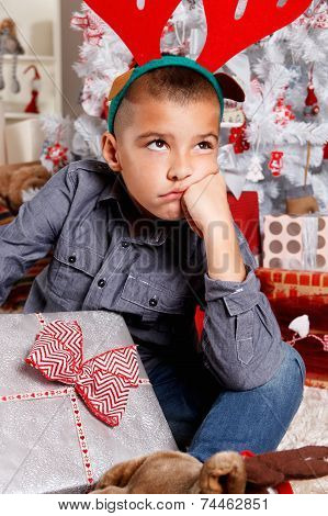 Sad Little Boy At Christmas