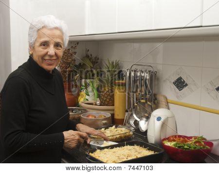 Senior Lady At Kitchen