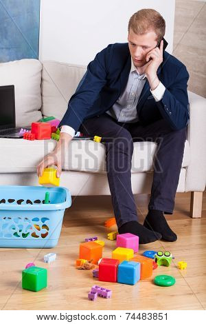 Elegant Man Cleaning Up Toys