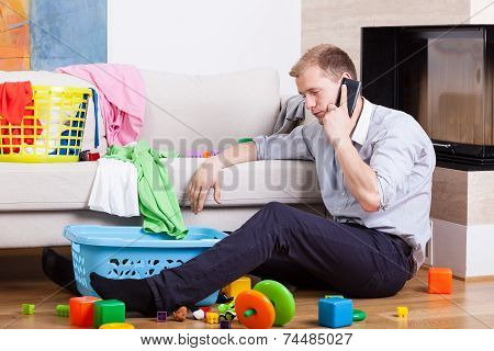 Dad Alone At Home With Child's Toys
