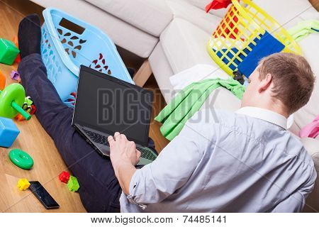 Man Using Laptop Sitting On The Floor