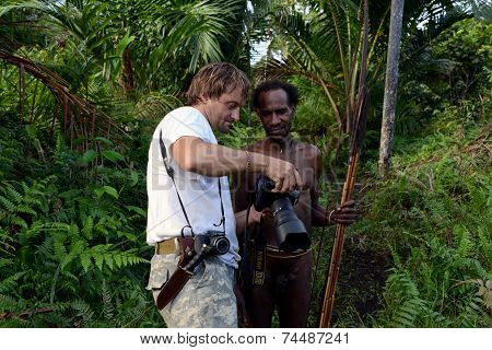 The Photographer And Papuan