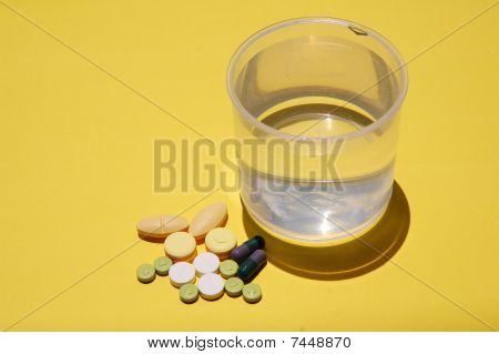 capsules and water