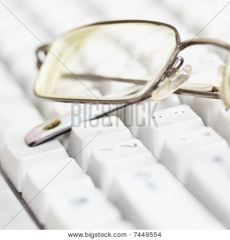 Spectacles Lie On Keyboard